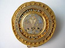 Disk brooch, Canosa di Puglia