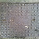 Manhole cover by N. Holman and Sons Ltd, St Just (Chapel Street, Penzance)