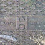 The mark of Harvey on a manhole cover, outside fire station Old County Hall, Truro.