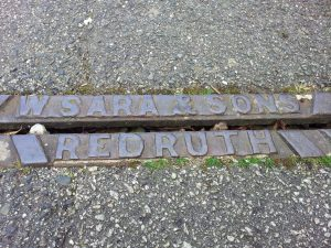 The mark of W. Sara and Sons, Redruth on pavement drain, Avondale Road, Truro.