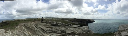 Panorama from the headland of Tintagel island, with new sculpture in mid-ground.