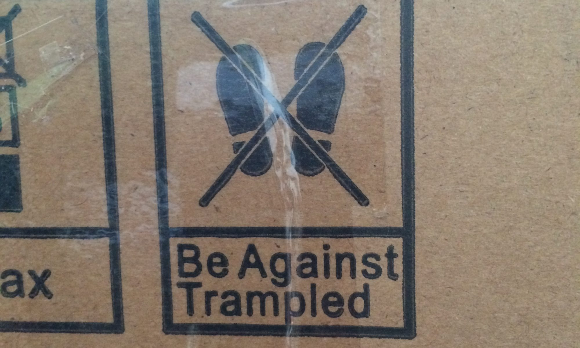 Cardboard box with sign saying Be Against Trampled.