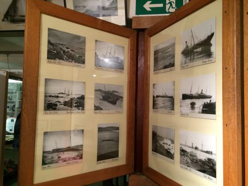 Photographic postcards displayed as museum objects in the Isles of Scilly Museum.